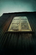 Silas Manhood EXTERIOR OF METAL SHACK WITH WINDOW Miscellaneous Buildings