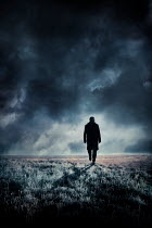 Silas Manhood SILHOUETTED MAN WALKING IN WINTRY COUNTRYSIDE Men