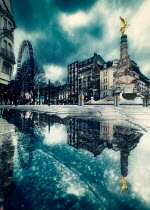 David Keochkerian GOLDEN ANGEL STATUE IN CITY REFLECTED IN PUDDLE Specific Cities/Towns
