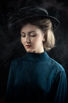 Natasza Fiedotjew close up of vintage woman in black hat
