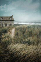 Ildiko Neer Stone cottage beside seaside