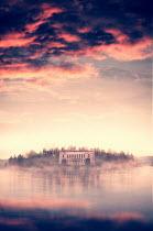 Lee Avison Mansion house on an island at dawn