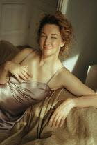 Maria Yakimova Woman in night dress sitting on sofa