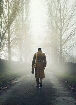 Mark Owen SOLDIER WALKING IN FOGGY COUNTRY ROAD