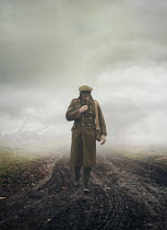 Mark Owen SOLDIER WALKING IN FOGGY MUDDY FIELD