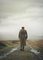 Mark Owen SOLDIER WALKING IN MISTY LANDSCAPE