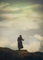 Mark Owen SOLDIER WITH GUN ON HILL WITH CLOUDS AND SKY