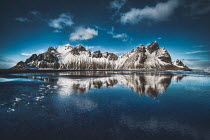 Evelina Kremsdorf SNOWY MOUNTAINS ON ISLAND BY SEA