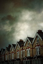 Miguel Sobreira ROW OF HISTORICAL HOUSES WITH STORMY SKY