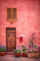 Evelina Kremsdorf EXTERIOR OF PINK HOUSE WITH FLOWER POTS AND SHUTTERS