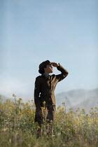 Ildiko Neer Wartime woman in uniform in meadow