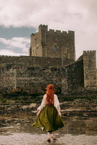 Rebecca Stice WOMAN WITH RED HAIR BY CASTLE ON BEACH