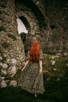 Rebecca Stice MEDIEVAL WOMAN WITH RED HAIR WALKING BY CASTLE