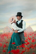 Ildiko Neer Historical couple in poppy field by mansion