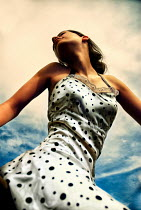 Metin Demiralay BRUNETTE GIRL IN SPOTTY DRESS OUTDOORS