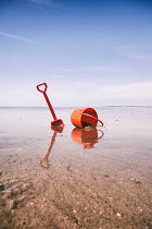 Tim Robinson BUCKET AND SPADE ON SANDY BEACH