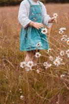 Shelley Richmond LITTLE GIRL PICKING FLOWERS IN FIELD
