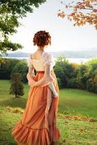 ILINA SIMEONOVA HISTORICAL WOMAN WITH RED HAIR WATCHING LAKE