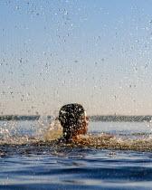 Stanislav Solntsev CHILD SWIMMING AND SPLASHING IN SEA