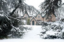 Andrew Davis HISTORICAL HOUSE WITH GARDEN IN SNOW