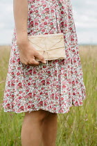 Shelley Richmond GIRL IN FLORAL DRESS HOLDING BUNDLE OF LETTERS
