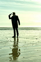 CollaborationJS MAN WITH GUN STANDING ON BEACH
