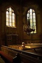Kerstin Marinov BLONDE WOMAN SITTING ON PEW INSIDE CHURCH