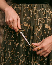 Rebecca Stice WOMAN PULLING DAGGER OUT OF CASE
