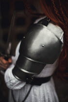 Rebecca Stice MEDIEVAL WOMAN IN ARMOUR HOLDING DAGGER