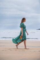 Marie Carr BAREFOOT WOMAN IN DRESS WALKING ON BEACH