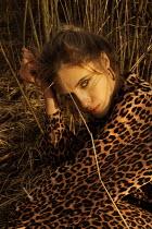 Elena Tyagunova WOMAN IN ANIMAL PRINT DRESS OUTDOORS