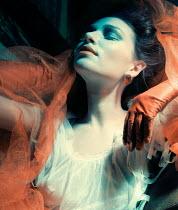 Elena Tyagunova DAYDREAMING WOMAN WITH ORANGE SCARF GLOVES AND EARRINGS