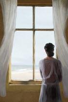 Mark Owen WOMAN AT WINDOW WATCHING SEA
