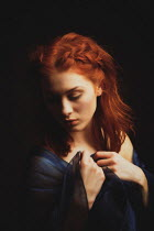 Nic Skerten SERIOUS WOMAN WITH RED HAIR IN SHADOW