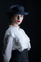Magdalena Russocka retro woman wearing hat holding her jacket