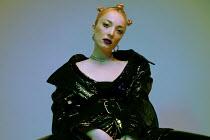 Elena Tyagunova BLONDE GIRL IN BLACK SHINY COAT