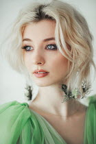 Jovana Rikalo BLONDE WOMAN IN GREEN GOWN WITH EARRINGS